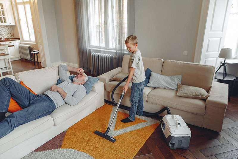 A boy helping to clean the house