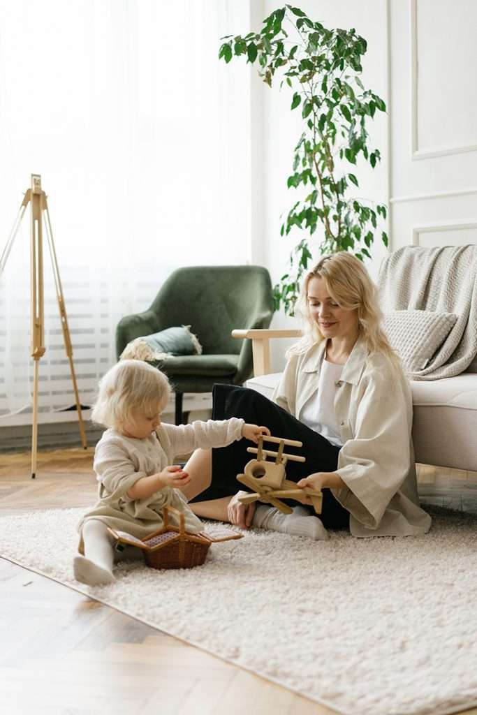 Mother and child sitting on a clean safe floor from non toxic floor cleaner