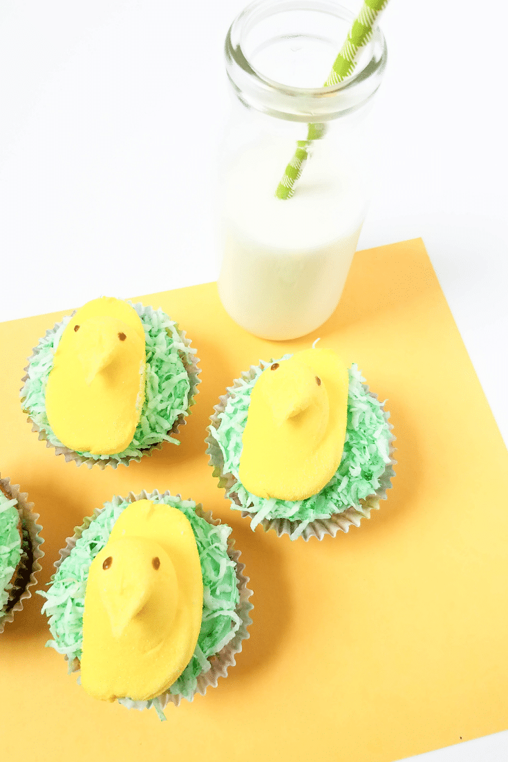 peeps cupcakes on placemat with glass of milk