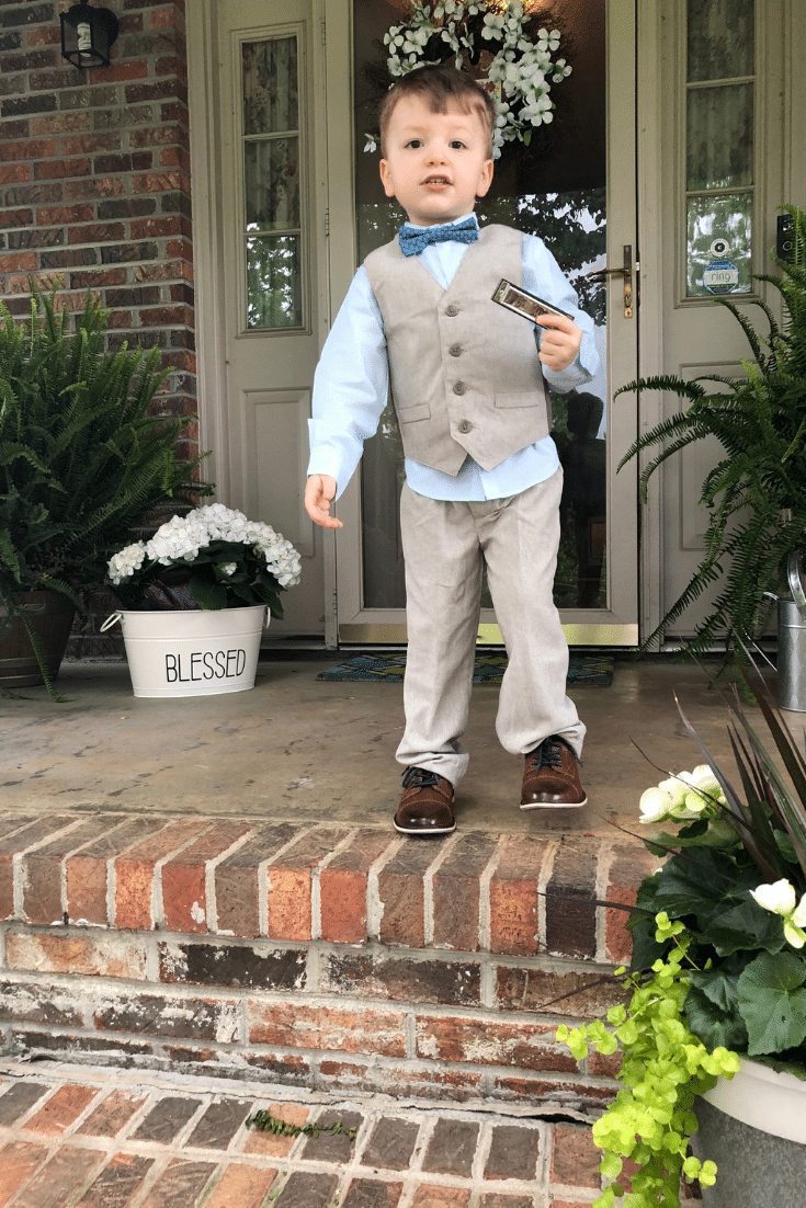 child on front porch in suit