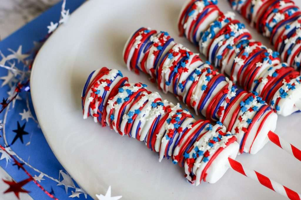 red, white, and blue patriotic marshmallow pops