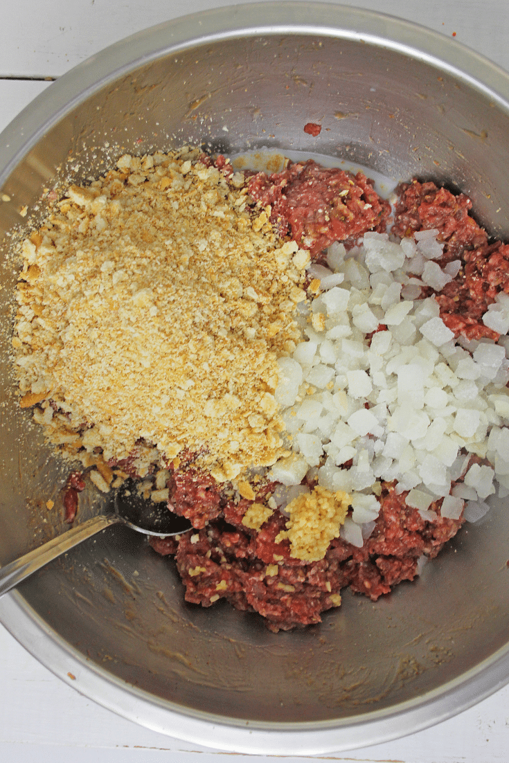 mixing ingredients for instant pot spaghetti and meatballs