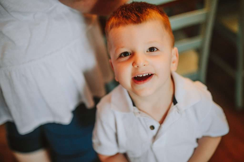 Toddler boy in white polo shirt