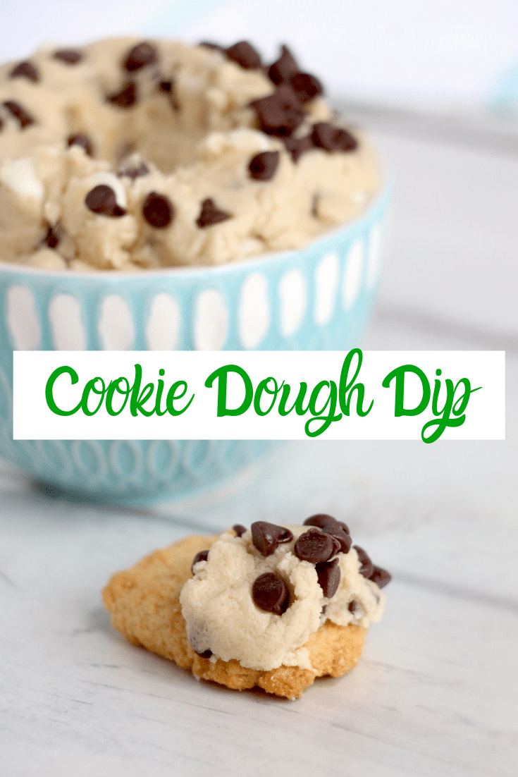 cookie dough dip in blue bowl, with some on a cookie