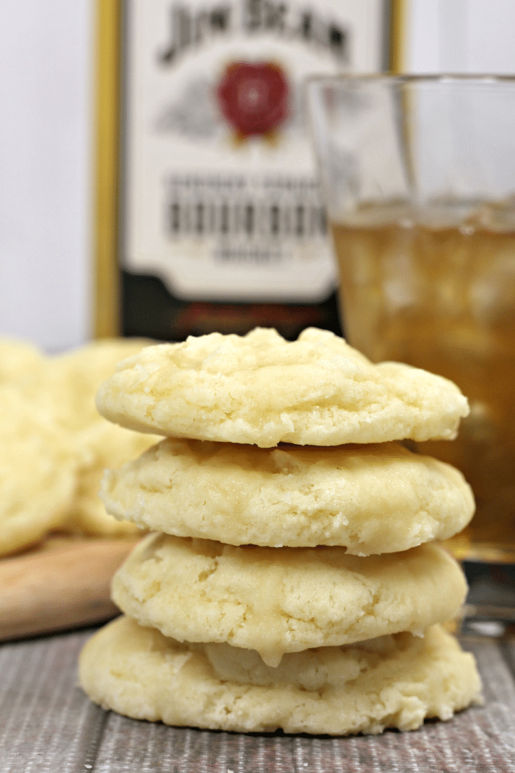 butter cookies stacked, with bottle of bourbon in background