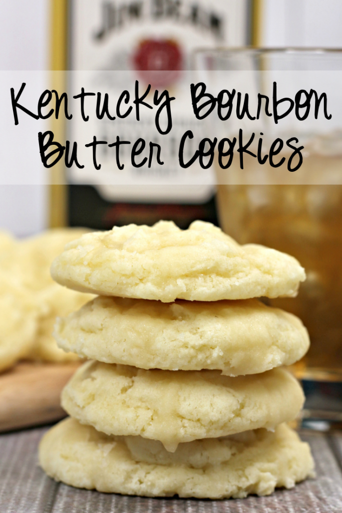 bourbon butter cookie stacked, with bottle of bourbon in back