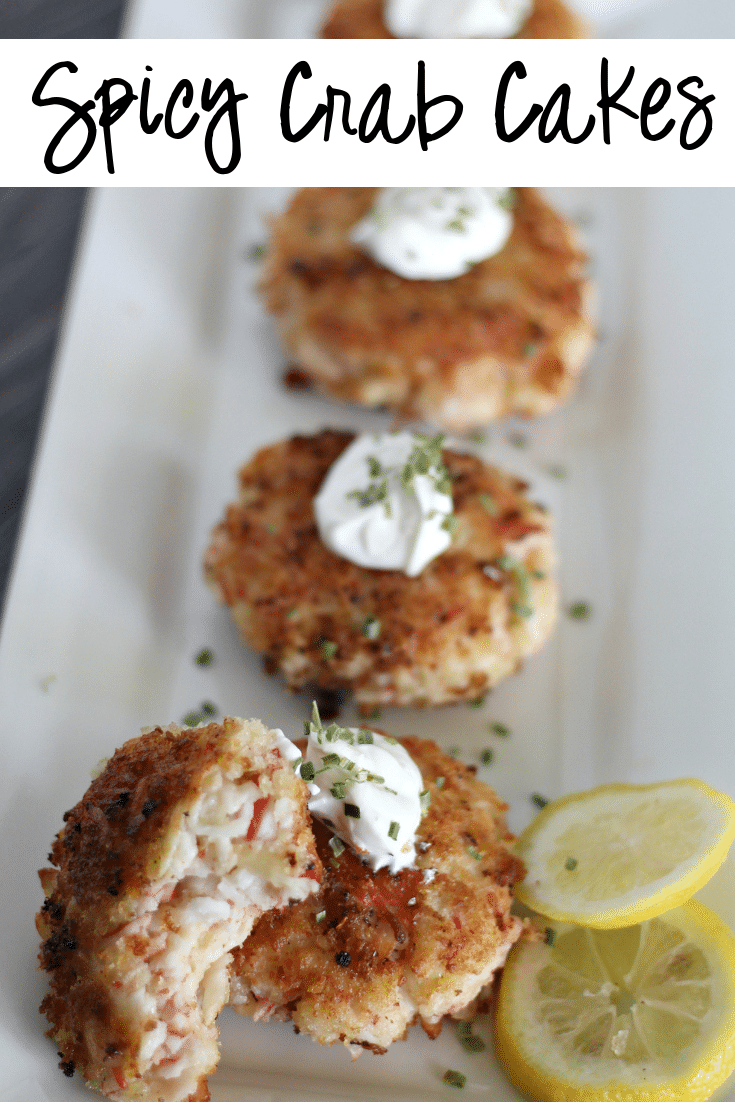 spicy crab cakes on white plate with lemon slice