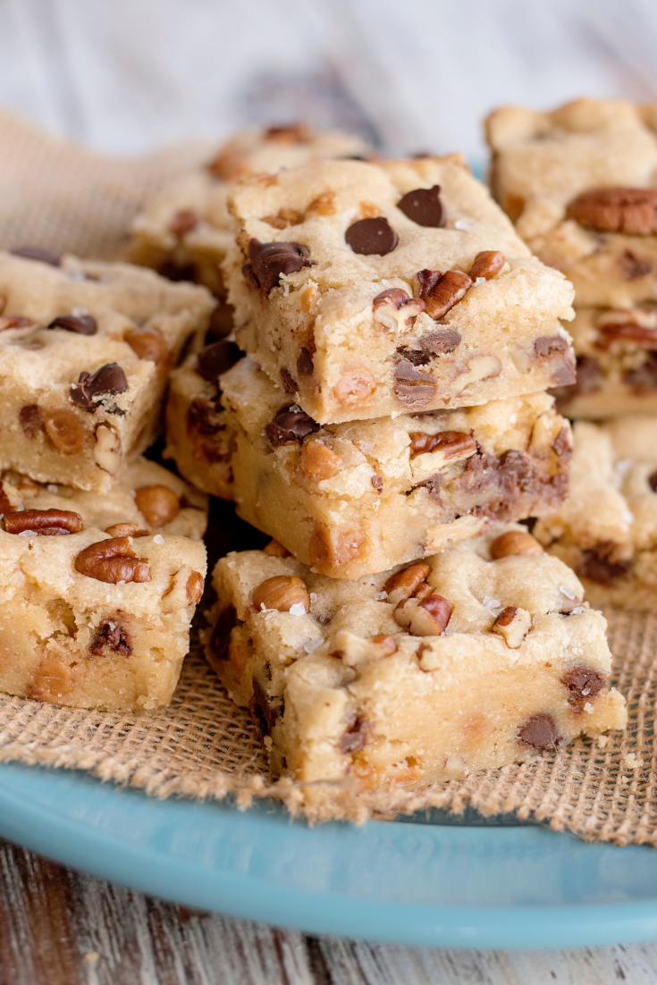 salted caramel chocolate chip cookie bars on blue plate