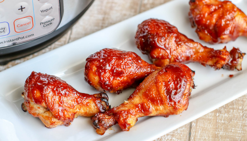 bbq chicken legs in front of instant pot