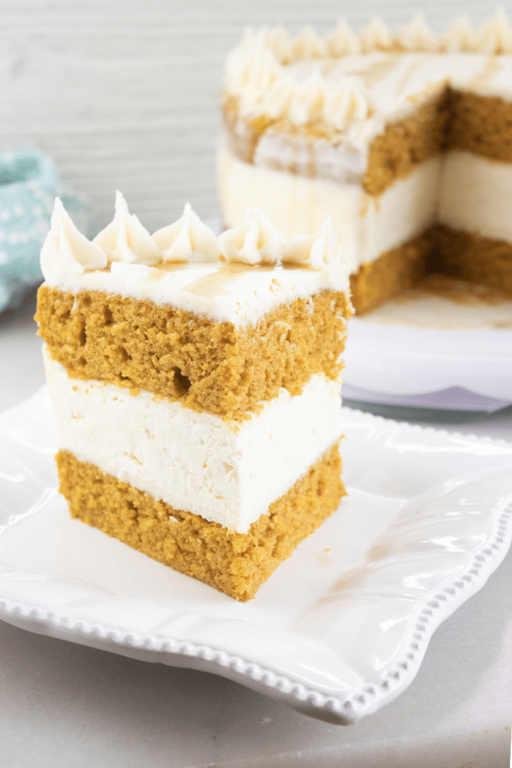 pumpkin cake with no bake cheesecake layer on white plate