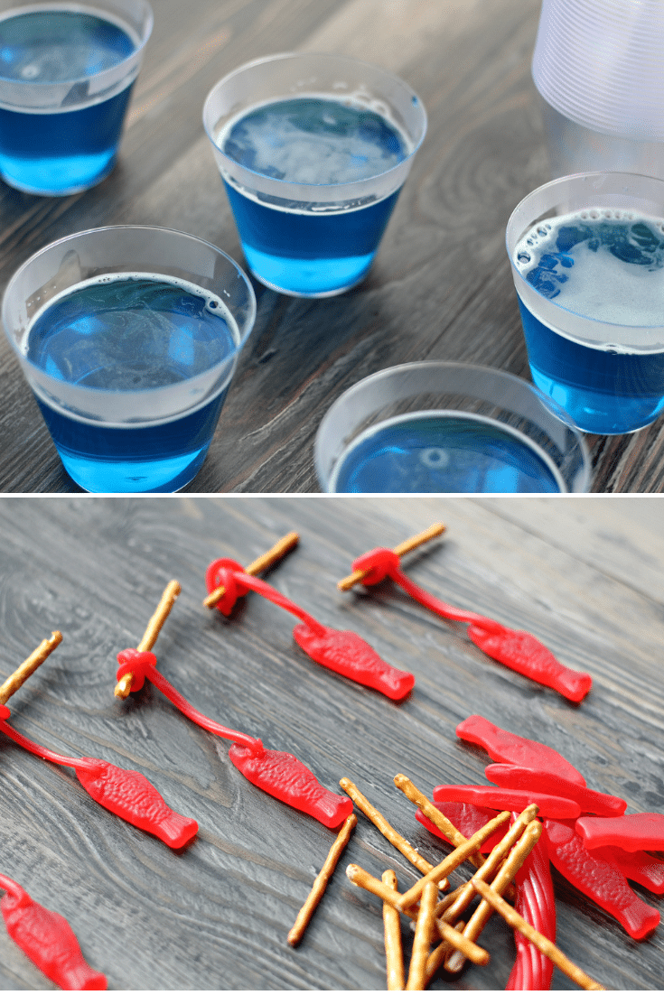 blue jello on top, swedish fish on pretzel rods on bottom