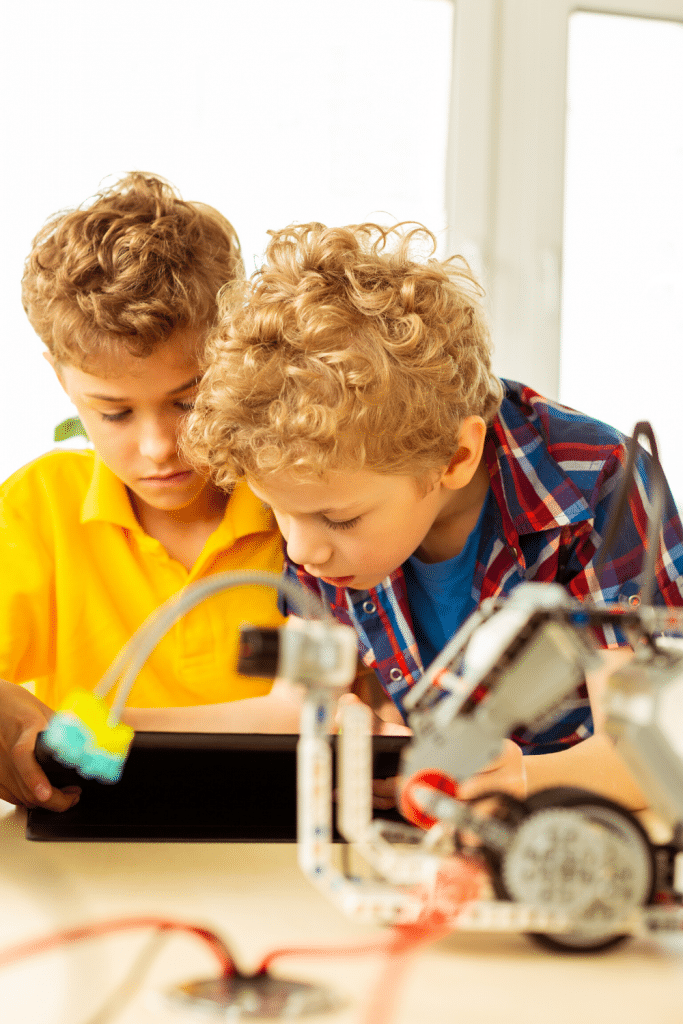2 boys looking at a science activity