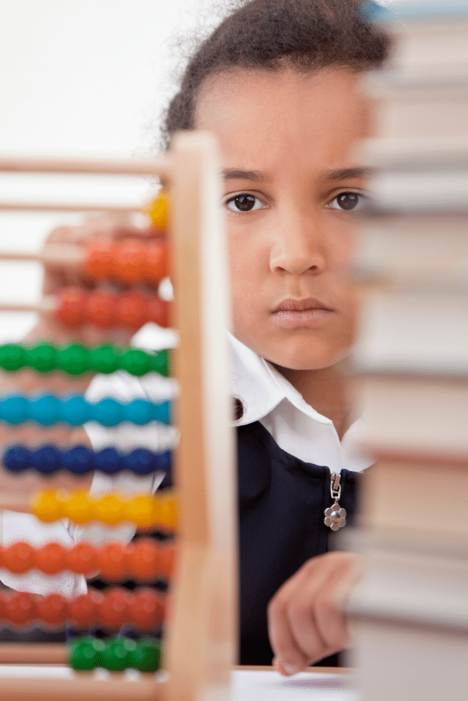 little girl looking at abacus