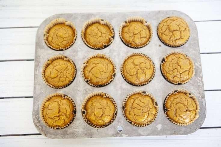 One Dozen Pumpkin Muffins on White Background