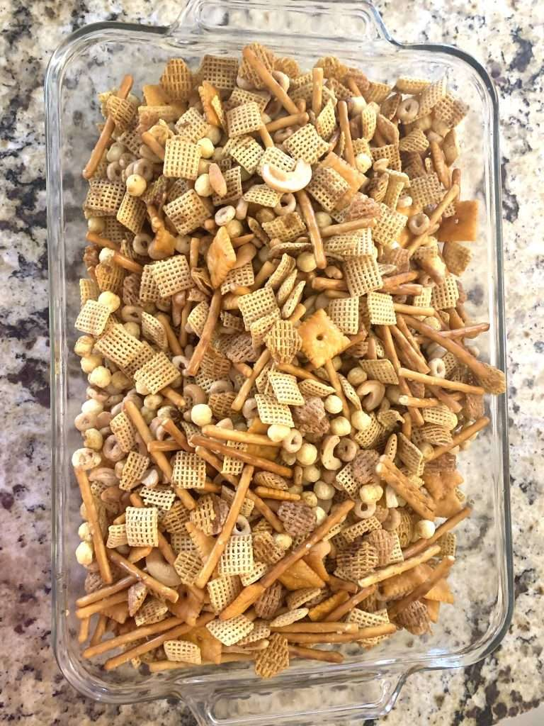 Large glass dish full of party mix
