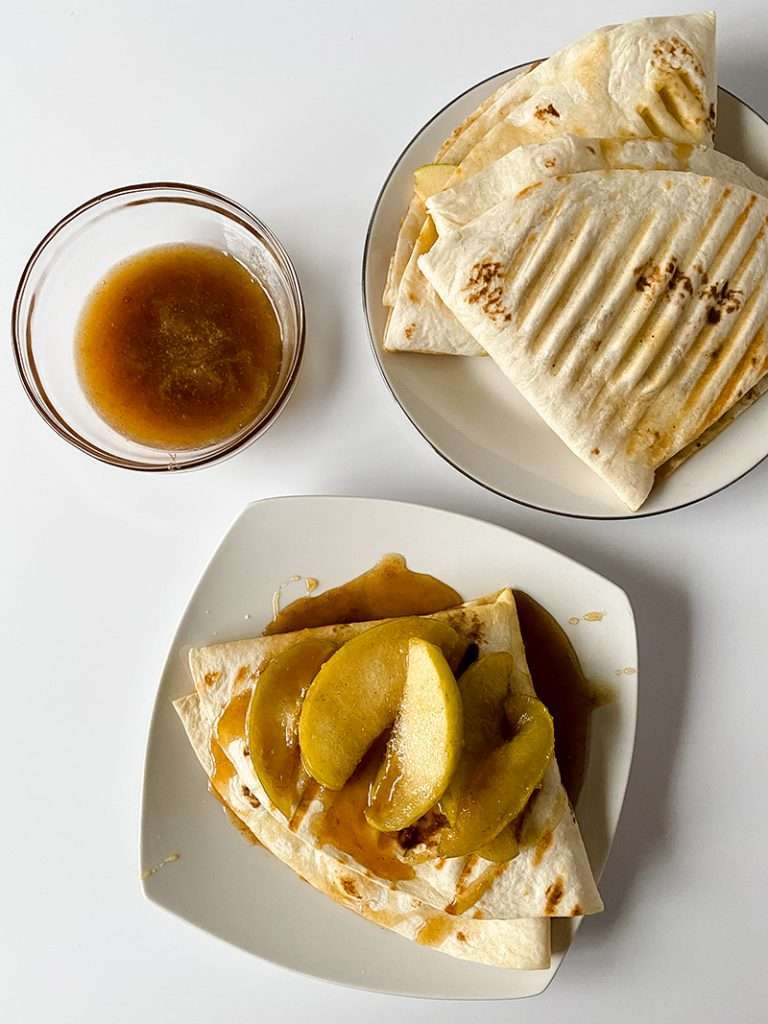 Completed caramel apple tortilla recipe from above showing apples and caramel sauce