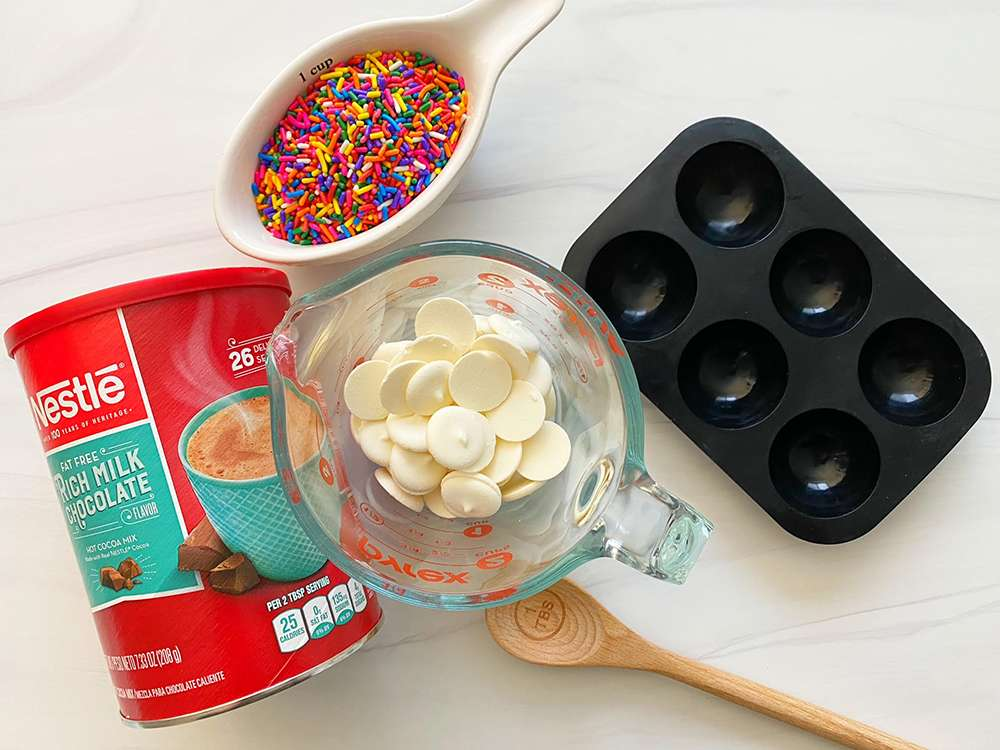 Ingredients to make white chocolate hot chocolate molds