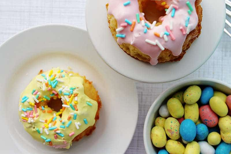 Yellow and pink mini bundt cakes with chocolate candy Easter eggs