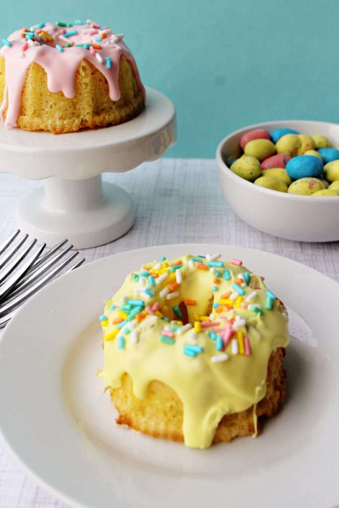 Easter mini bundt cake recipe with yellow icing and rainbow sprinkles