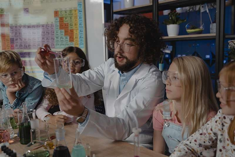 Scientist doing experiments with kids at home