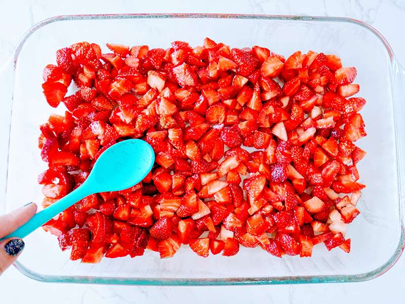 sliced strawberries in a baking dish