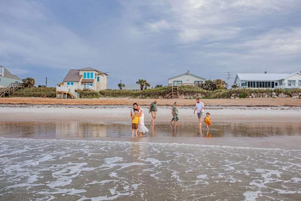 Family playing in water on beach in St. Augustine Florida